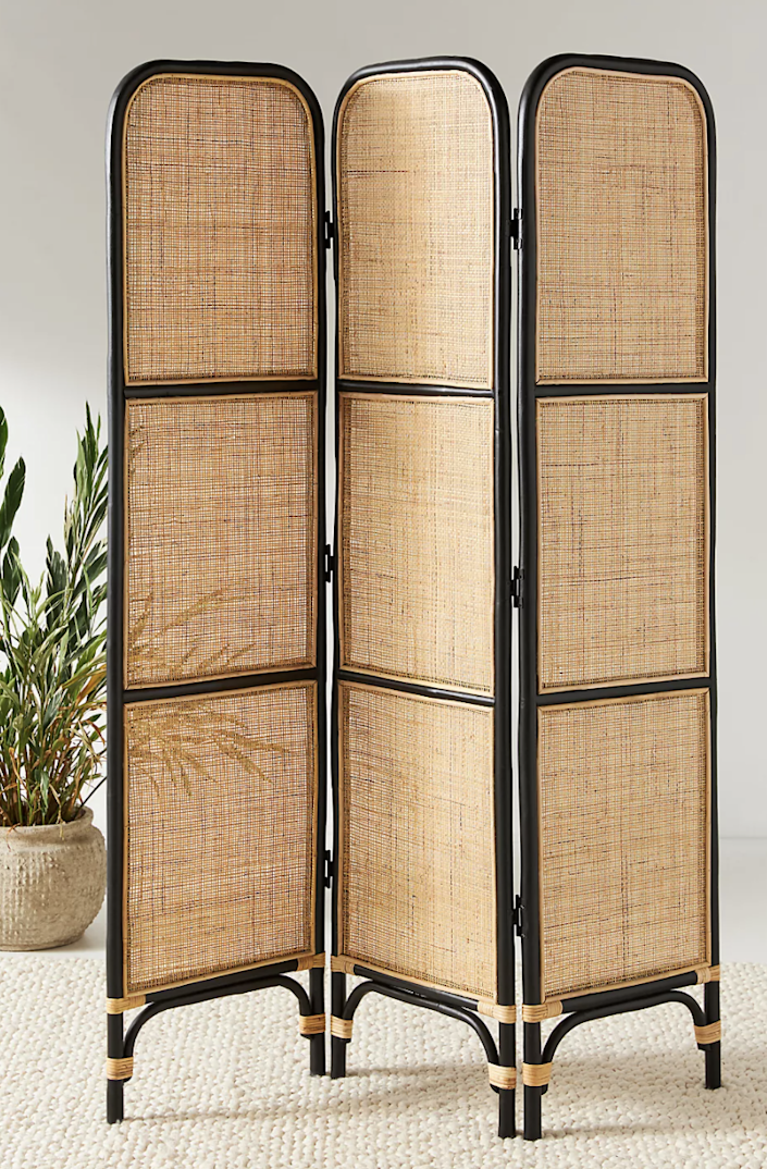 "$398, Anthropologie. <a href=""https://www.anthropologie.com/shop/scarlett-rattan-room-divider-screen?color=014&type=STANDARD&size=One%20Size&quantity=1"" rel=""nofollow noopener"" target=""_blank"" data-ylk=""slk:Get it now!"" class=""link rapid-noclick-resp"">Get it now!</a>"