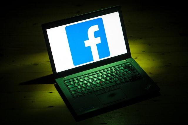 The logo of social networking site Facebook is displayed on a laptop