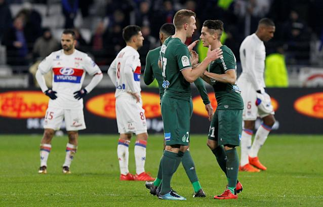 Soccer Football - Ligue 1 - Olympique Lyonnais vs Saint-Etienne - Groupama Stadium, Lyon, France - February 25, 2018 St Etienne's Robert Beric and Romain Hamouma celebrate after the match REUTERS/Emmanuel Foudrot