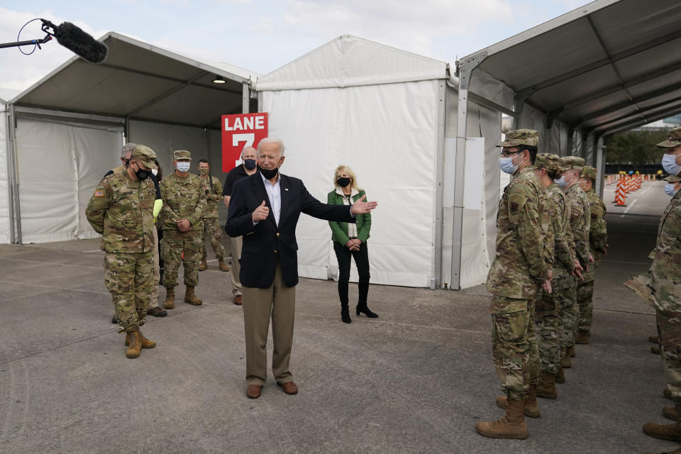 President Joe Biden speaks at a FEMA COVID-19 mass vaccination site at NRG Stadium, Friday, Feb. 26, 2021, in Houston. (AP Photo/Patrick Semansky)