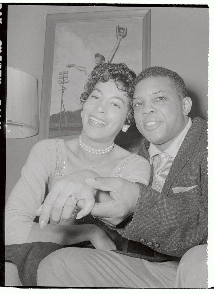 <p>Professional baseball player Willie Mays shows off his wife's wedding band at their home in 1956. They were married until 1963. </p>