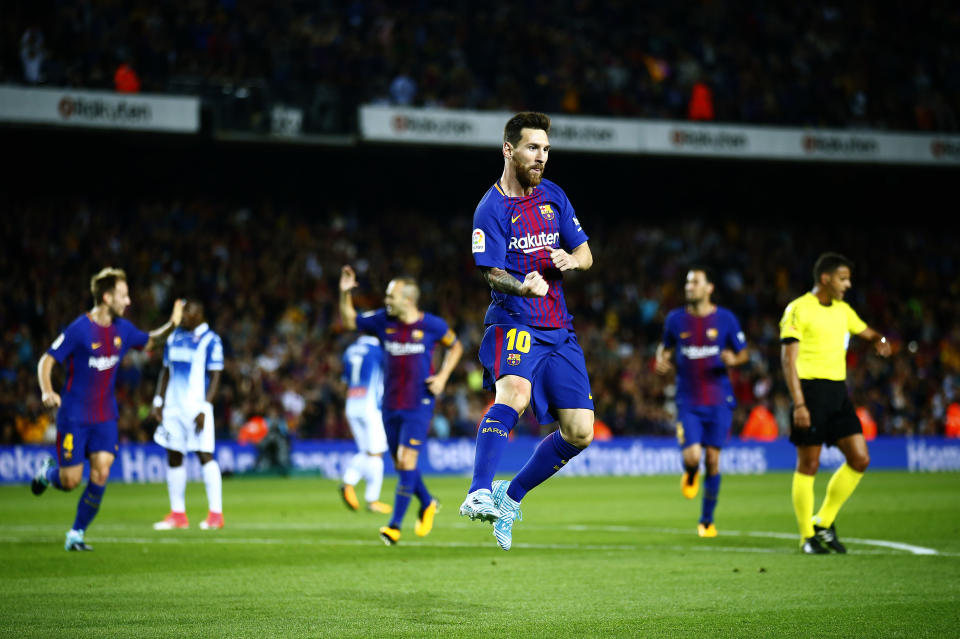 Lionel Messi (foreground) and Barcelona sure didn't look troubled in a 5-0 win over rival Espanyol. (AP)