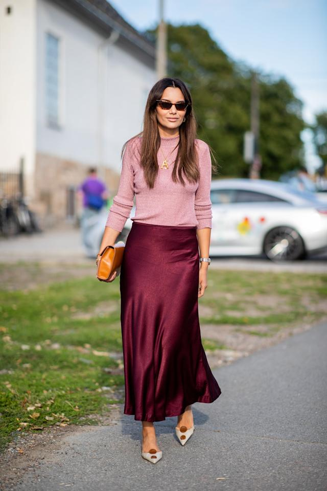 <p>With a slim-fit crewneck sweater and silk midi skirt, you're ready for whatever the day (and night!) might throw at you.</p>