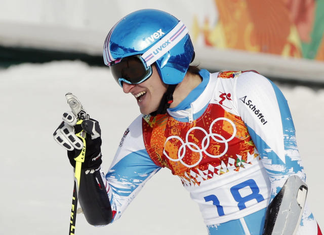 Austria's Matthias Mayer smiles after finishing the first run of the men's giant slalom at the Sochi 2014 Winter Olympics, Wednesday, Feb. 19, 2014, in Krasnaya Polyana, Russia. (AP Photo/Christophe Ena)