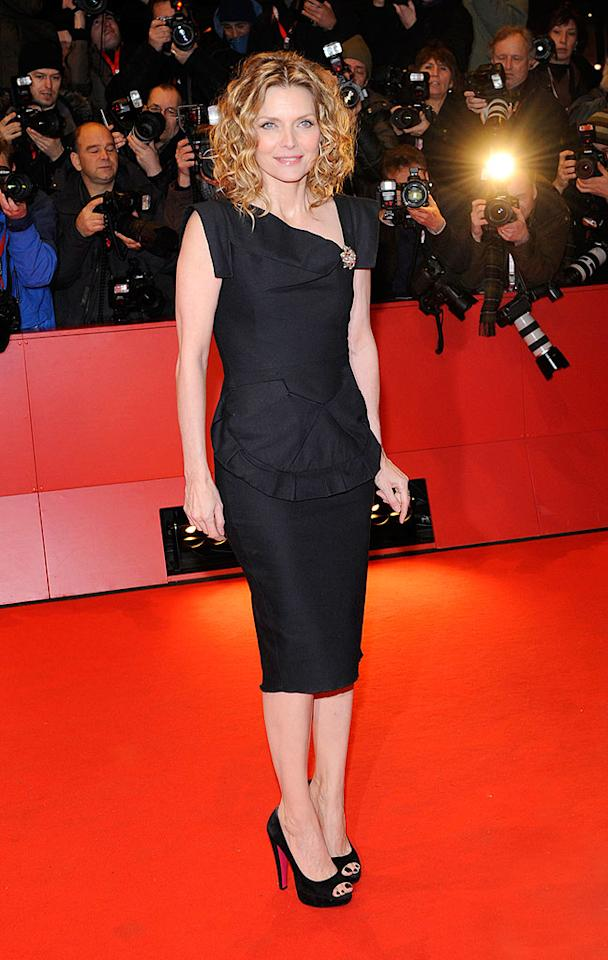"""50-year-old Michelle Pfeiffer put women half her age to shame in a broach-enhanced RM by Roland Mouret dress and sexy tousled tresses at the Berlin Film Fest. A-way!/<a href=""""http://www.splashnewsonline.com"""" target=""""new"""">Splash News</a> - February 10, 2009"""