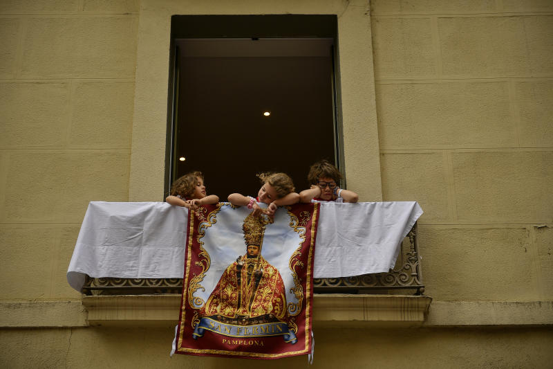 Young girls and a boy wait to see the procession from a balcony at the San Fermin Festival in Pamplona, northern Spain, Sunday, July 7, 2019. (Photo: Alvaro Barrientos/AP)