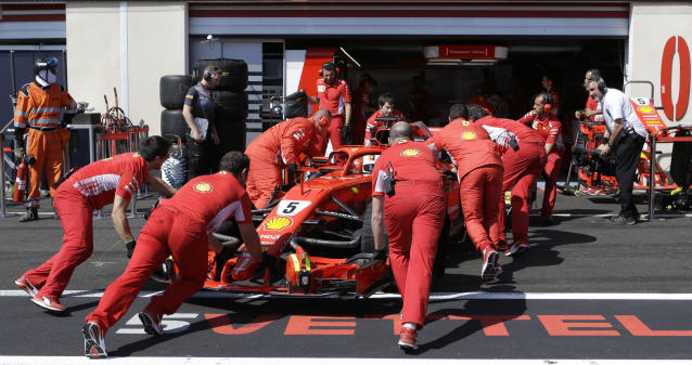 Ferrari driver Sebastian Vettel of Germany gets a pit service during the second free practice at the Paul Ricard racetrack, in Le Castellet, southern France, Friday, June 22, 2018. The Formula one race will be held on Sunday. (AP Photo/Claude Paris)