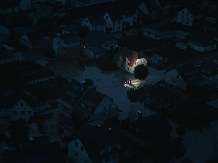 """Rescuers search for flood victims at night in the village of Dernau, Germany on July 15, 2021.<span class=""""copyright"""">DOCKS Collective</span>"""