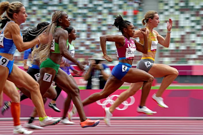 Javianne Oliver of the U.S. competes in the women's 100-meter quarterfinal heats at Olympic Stadium.