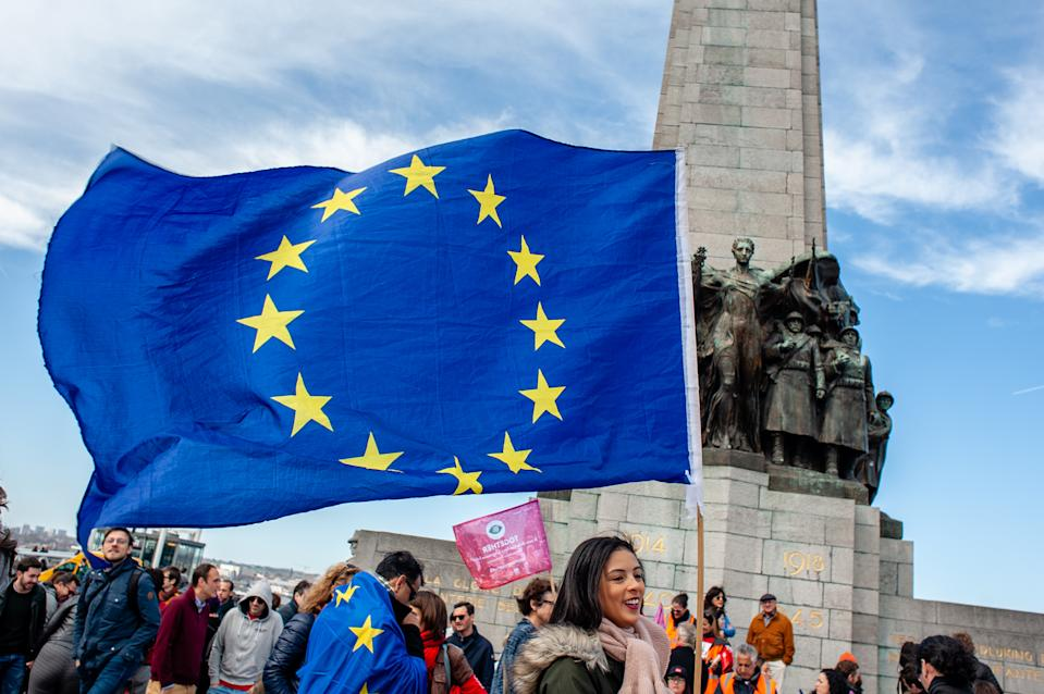 A woman is seen holding a flag of the EU in front of the monument at the Poulaert square during the protest. A day before the anniversary of the founding Treaty of the European Union, citizens and civil society organizations took the streets of Brussels to make a stand, two months before the European elections. The march was organized by together platform, an initiative launched by an alliance of progressive political groups from across Europe. They stand for solidarity, democracy, and peace against the real threat to their core European values. (Photo by Ana Fernandez / SOPA Images/Sipa USA)