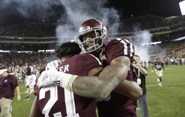 Texas A&M wide receiver Kendrick Rogers celebrates with Charles Oliver (21) after an NCAA college football game against LSU Saturday, Nov. 24, 2018, in College Station, Texas. Texas A&M won 74-72 in seven overtimes. (AP Photo/David J. Phillip)