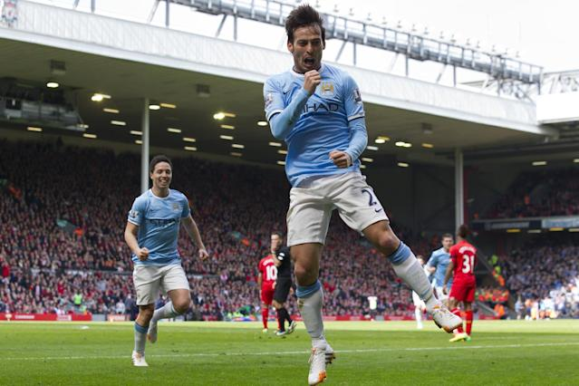 Manchester City's David Silva celebrates after scoring his second goal against Liverpool during their English Premier League soccer match at Anfield Stadium, Liverpool, England, Sunday April 13, 2014. (AP Photo/Jon Super)