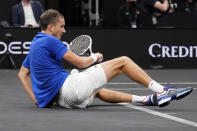 Team Europe's Daniil Medvedev, of Russia, falls while competing against Team World's Denis Shapovalov, of Canada, during Laver Cup tennis, Saturday, Sept. 25, 2021, in Boston. (AP Photo/Elise Amendola)