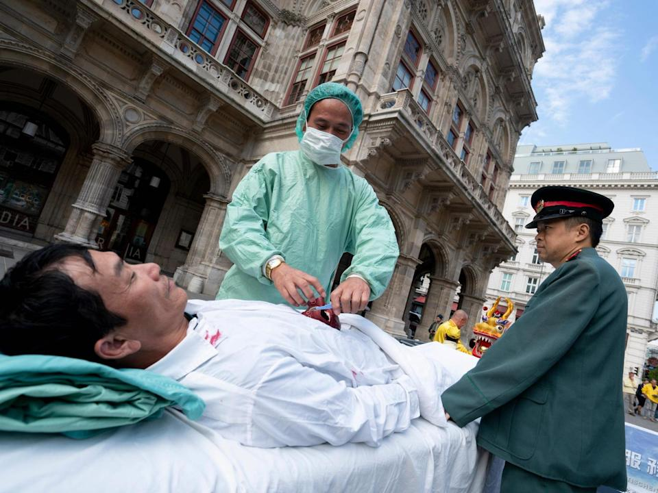 Falun Gong supporters in Austria stage protest against organ harvesting: AFP/Getty Images