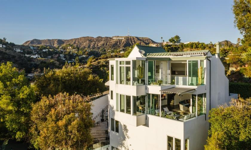Spanning four stories, the 2,500-square-foot home takes advantage of the setting with walls of glass and multiple terraces.