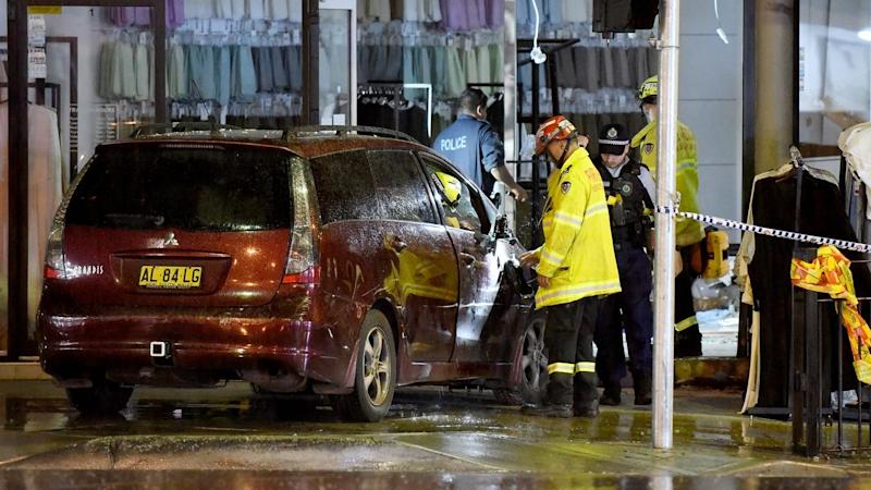 A driver has been released from police custody after earlier crashing into a Sydney hijab shop