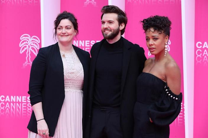 """The cast of """"The Feed"""" includes Guy Burnet (C) and Nina Toussaint-White (R) (AFP Photo/VALERY HACHE)"""