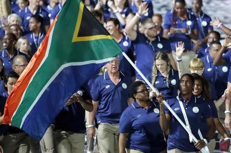 Gold Coast 2018 Commonwealth Games - Opening ceremony - Carrara Stadium - Gold Coast, Australia - April 4, 2018 - Caster Semenya of South Africa carries the national flag during the opening ceremony. REUTERS/Jeremy Lee