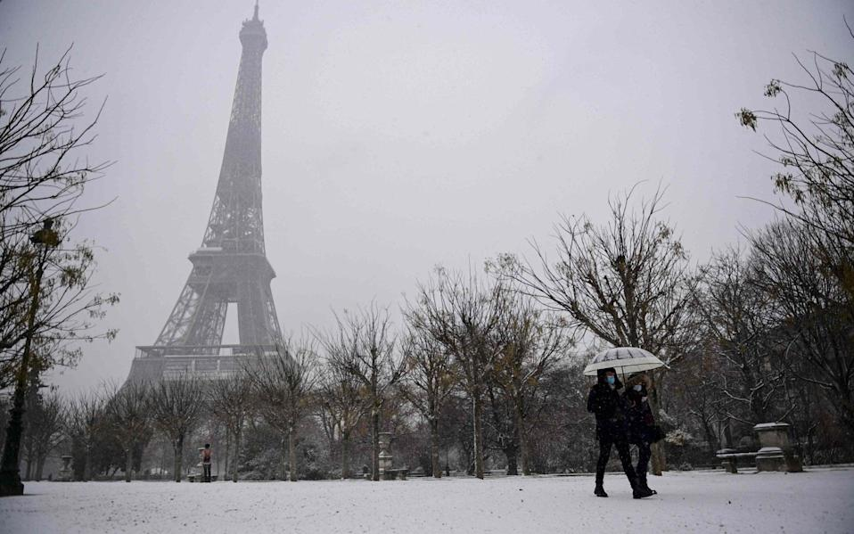 The cold weather has chilled Europe too, with snow blanketing Paris - GETTY IMAGES
