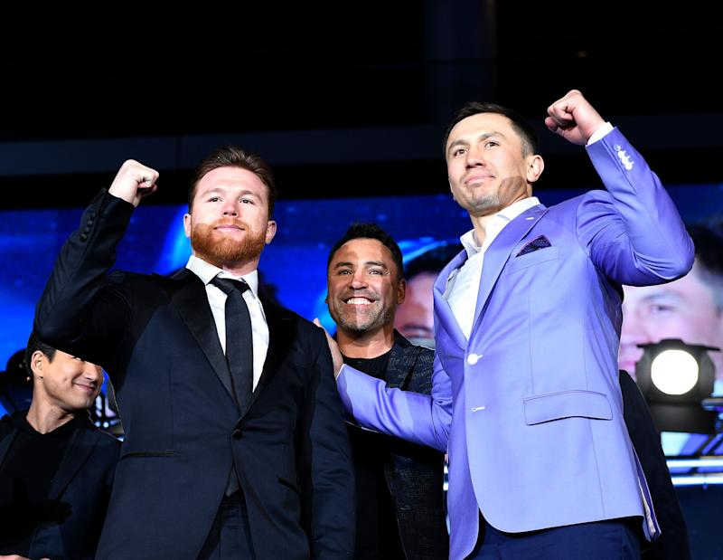 LOS ANGELES, CA - FEBRUARY 27: Boxers Canelo Alvarez (L) boxing promoter and former professional boxer Oscar De La Hoya (C) and Gennady Golovkin pose during a news conference at Microsoft Theater at L.A. Live to announce their upcoming rematch on February 27, 2018 in Los Angeles, California. (Photo by Kevork Djansezian/Getty Images)