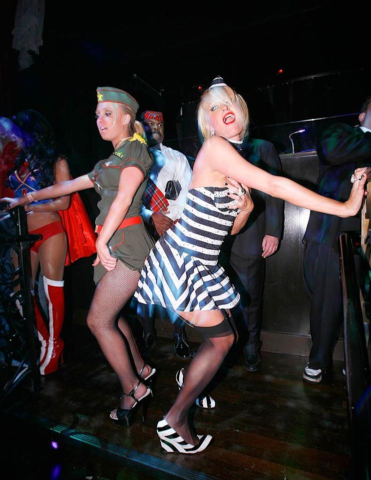 """Paris gets her dirty dance on with a fellow partygoer. The formerly-imprisoned princess had a difficult time keeping her top up. What happens in Vegas, stays in Vegas. Chris Weeks/<a href=""""http://www.wireimage.com"""" target=""""new"""">WireImage.com</a> - October 31, 2007"""