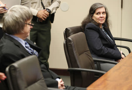 Louise Turpin looks over at David Turpin as they appear in court in Riverside, California, U.S., February 23, 2018. REUTERS/Gina Ferazzi/Pool