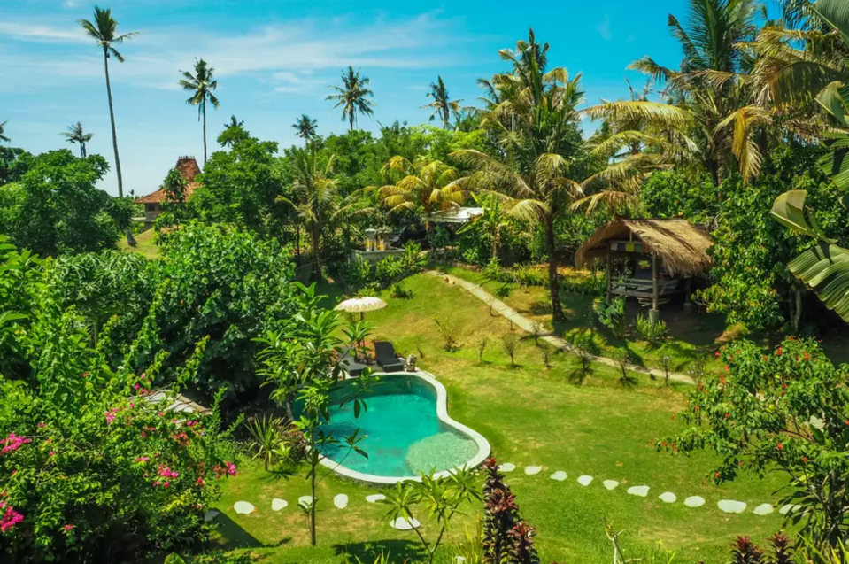 """<p>Don't worry about packing snacks. Guests of this popular <span class=""""redactor-unlink"""">Airbnb rental</span> in Indonesia can roam the garden and pick fresh coconuts, papayas, and passion fruit during their island escape.</p><p><a class=""""link rapid-noclick-resp"""" href=""""https://www.airbnb.com/rooms/1016153"""" rel=""""nofollow noopener"""" target=""""_blank"""" data-ylk=""""slk:BOOK NOW"""">BOOK NOW</a> <strong><em>Balian Treehouse</em></strong><br></p>"""