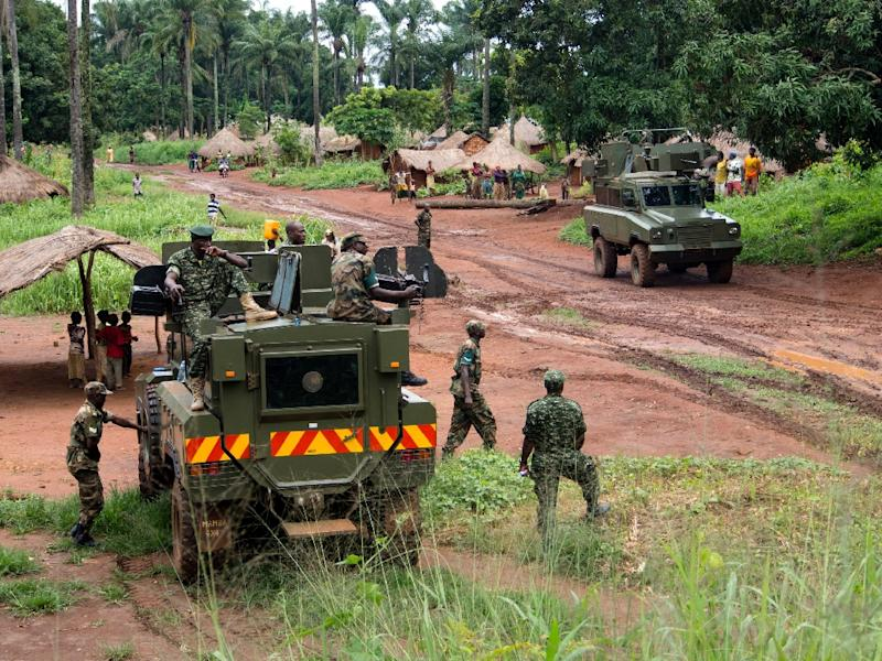 Soldiers patrol in the northeastern part of the Central African Republic to secure the area from possible LRA attacks, on June 25, 2014