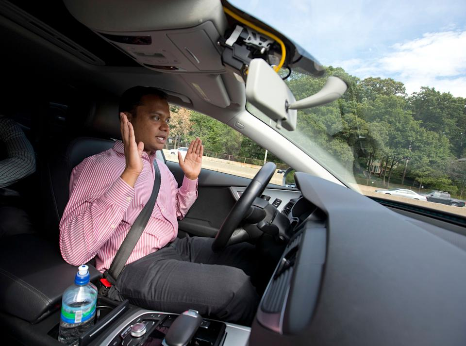 Kaushik Raghu, Senior Staff Engineer at Audi, takes his hands off the steering wheel while demonstrating an Audi self driving vehicle on I-395 expressway in Arlington, Va., Friday, July 15, 2016. Experts say the development of self-driving cars over the coming decade depends on an unreliable assumption by most automakers: that the humans in them will be ready to step in and take control if the car's systems fail. Experience with automation in other modes of transportation suggests that strategy will lead to more deaths like that of a Florida Tesla driver in May. (AP Photo/Pablo Martinez Monsivais)