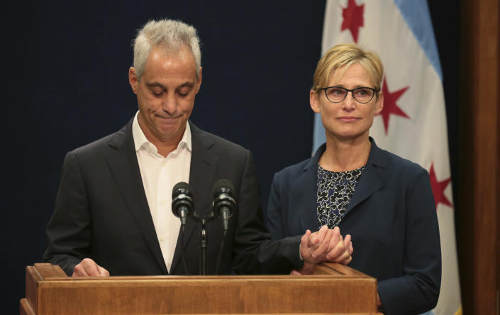 With wife Amy Rule by his side, Chicago Mayor Rahm Emanuel announces Tuesday, Sept. 4, 2018, he will not seek a third term in office at a press conference on the 5th floor at City Hall in Chicago. (Stacey Wescott/Chicago Tribune via AP)