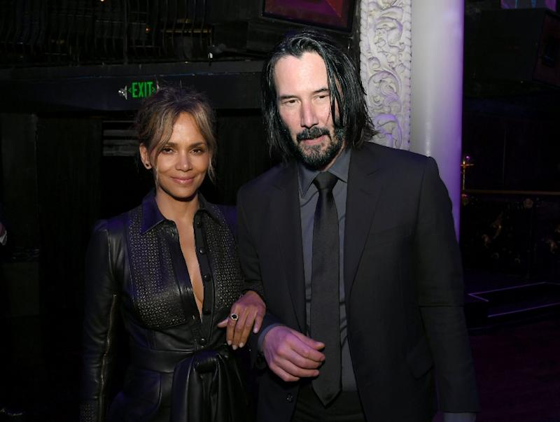"""Keanu Reaves and Halle Berry are seen at a May 15, 2019 screening in Hollywood of Lionsgate's latest """"John Wick"""" movie, which topped North American box offices in its opening weekend, beating blockbuster """"Avengers: Endgame"""""""