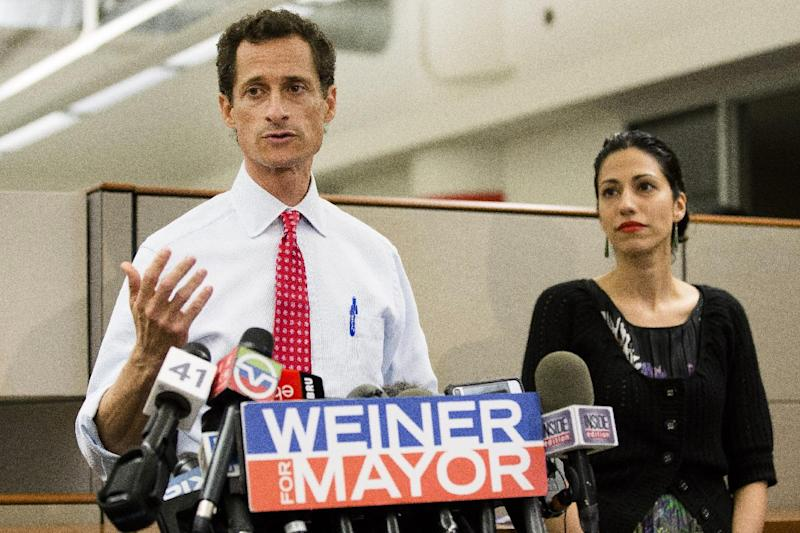 New York mayoral candidate Anthony Weiner speaks during a news conference alongside his wife Huma Abedin at the Gay Men's Health Crisis headquarters, Tuesday, July 23, 2013, in New York. The former congressman says he's not dropping out of the New York City mayoral race in light of newly revealed explicit online correspondence with a young woman. (AP Photo/John Minchillo)