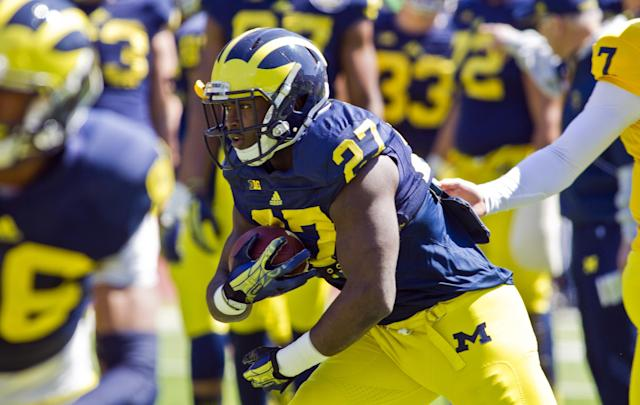 Michigan running back Derrick Green (27) takes a handoff and rushes during the NCAA college football team's annual spring game on Saturday, April 5, 2014, in Ann Arbor, Mich. (AP Photo/Tony Ding)