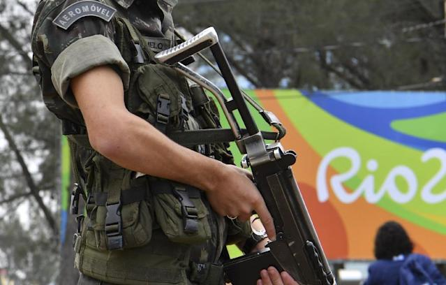 A Brasilian soldier stands guard near the Riocentro complex in Rio de Janeiro, on August 3, 2016, ahead of the Rio 2016 Olympic Games (AFP Photo/Yuri Cortez)
