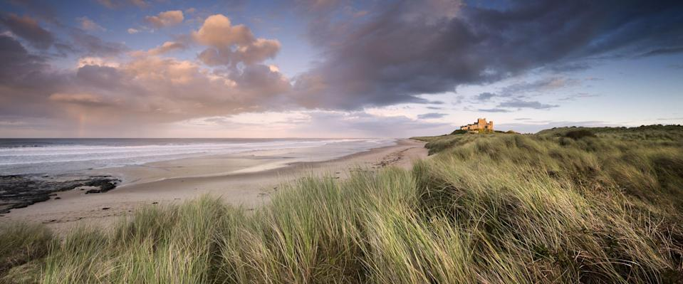 """<p>When the summer crowds have dispersed, there's an opportunity to have the UK's wild and wind-beaten coast all to yourself. But where are Britain's best winter <a href=""""https://www.countryliving.com/uk/travel-ideas/staycation-uk/a33453496/best-beaches-britain-the-sunday-times/"""" rel=""""nofollow noopener"""" target=""""_blank"""" data-ylk=""""slk:beaches"""" class=""""link rapid-noclick-resp"""">beaches</a> for a wave-crashingly scenic escape?</p><p><strong>Covid-19: Check the latest guidance for <a href=""""https://www.gov.uk/government/publications/coronavirus-outbreak-faqs-what-you-can-and-cant-do/coronavirus-outbreak-faqs-what-you-can-and-cant-do#visiting-public-places-and-taking-part-in-activities"""" rel=""""nofollow noopener"""" target=""""_blank"""" data-ylk=""""slk:England"""" class=""""link rapid-noclick-resp"""">England</a>, <a href=""""https://www.nidirect.gov.uk/articles/coronavirus-covid-19-regulations-guidance-travel"""" rel=""""nofollow noopener"""" target=""""_blank"""" data-ylk=""""slk:Northern Ireland"""" class=""""link rapid-noclick-resp"""">Northern Ireland</a>, <a href=""""https://www.gov.scot/publications/coronavirus-covid-19-what-you-can-and-cannot-do/pages/getting-around/"""" rel=""""nofollow noopener"""" target=""""_blank"""" data-ylk=""""slk:Scotland"""" class=""""link rapid-noclick-resp"""">Scotland</a> and <a href=""""https://gov.wales/coronavirus-regulations-guidance"""" rel=""""nofollow noopener"""" target=""""_blank"""" data-ylk=""""slk:Wales"""" class=""""link rapid-noclick-resp"""">Wales</a>, including local restrictions and alert levels, before travelling.</strong></p><p>Turn your collars up to the wind, wrap up warm and explore silky sands, rugged coastlines, clifftop views, wildlife-rich rock pools and picturesque coastal paths – all with the added drama and atmospheric beauty of unpredictable weather.</p><p>The UK's beaches boast another level of stirring beauty in winter, and there's nothing like the promise of a post-walk local ale or warming hot chocolate at a cosy old pub to enhance the trip.</p><p>Head to Northumberland for stretches of dune-backed golden sands ov"""
