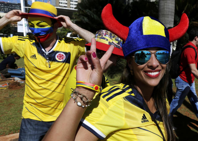 Spectators arrive at the Estadio Nacional for the group C World Cup soccer match between Colombia and Ivory Coast in Brasilia, Brazil, Thursday, June 19, 2014. (AP Photo/Fernando Llano)