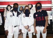 Athletes Daryl Homer (Fencing), from left, Jordyn Barratt (Skateboard) and Heimana Reynolds (Skateboard) participate in the Team USA Tokyo Olympic closing ceremony uniform unveiling at the Ralph Lauren SoHo Store on April 13, 2021, in New York. Ralph Lauren is an official outfitter of the 2021 U.S. Olympic Team. (Photo by Evan Agostini/Invision/AP)