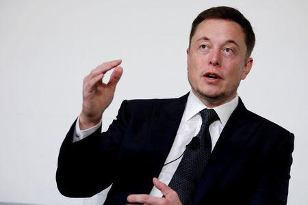 FILE PHOTO - Elon Musk speaks at the International Space Station Research and Development Conference in Washington