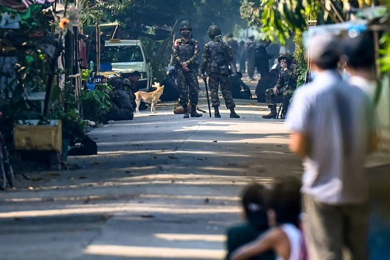 Soldiers blocked a road at Yangon's Mahlwagone Railway Station when they swept in to arrest railway staff who refuse to work with Myanmar's military regime