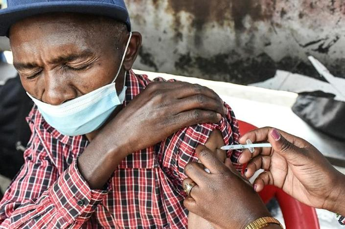 A man is inoculated with a Moderna Covid-19 vaccine in Nairobi on September 17, 2021. (AFP/Simon MAINA)