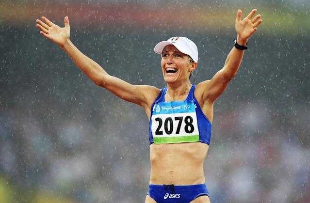 BEIJING - AUGUST 21: Elisa Rigaudo of Italy celebrates third place in the Women's 20km Walk Final and the bronze medal held at the National Stadium during Day 13 of the Beijing 2008 Olympic Games on August 21, 2008 in Beijing, China. (Photo by Jed Jacobsohn/Getty Images)