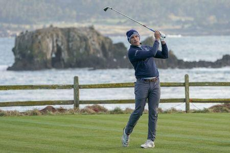 February 10, 2019; Pebble Beach, CA, USA; Scott Stallings hits his tee shot on the 18th hole during the final round of the AT&T Pebble Beach Pro-Am golf tournament at Pebble Beach Golf Links. Mandatory Credit: Kyle Terada-USA TODAY Sports