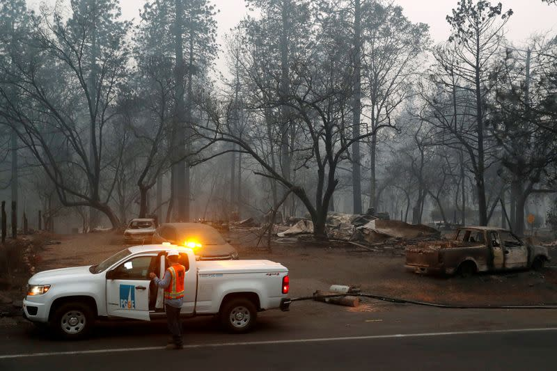 FILE PHOTO: Employees of Pacific Gas & Electric work in the aftermath of the Camp Fire in Paradise