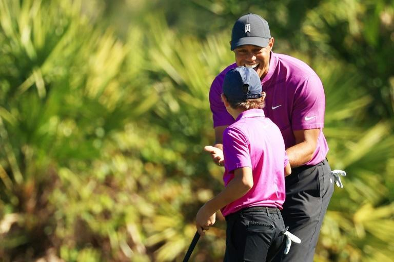 Tiger Woods congratulates son Charlie on his eagle in the first round of the PNC Challenge in Orlando, Florida