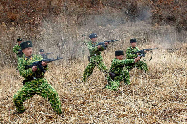 <p>North Korean soldiers with weapons attend military training in an undisclosed location in this picture released by the North's official KCNA news agency in Pyongyang, North Korea, March 11, 2013. (KCNA/Reuters) </p>