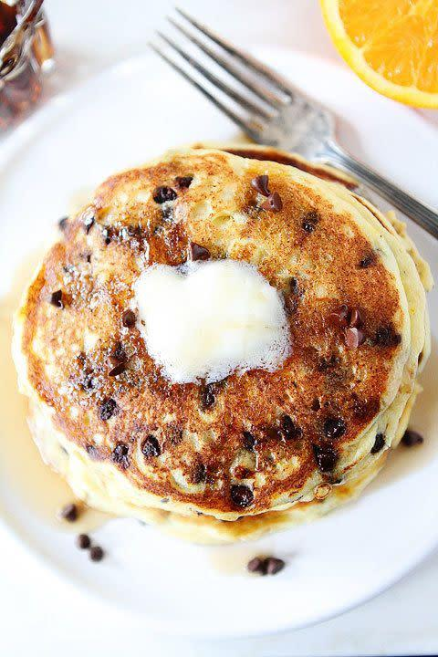 "<strong>Get the <a href=""http://www.twopeasandtheirpod.com/orange-ricotta-chocolate-chip-pancakes/"" rel=""nofollow noopener"" target=""_blank"" data-ylk=""slk:Orange Ricotta Chocolate Chip Pancakes recipe"" class=""link rapid-noclick-resp"">Orange Ricotta Chocolate Chip Pancakes recipe</a> from Two Peas and their Pod</strong>"