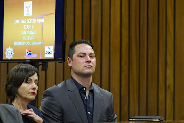 PRETORIA, SOUTH AFRICA - APRIL 11: (SOUTH AFRICA OUT): Carl Pistorius listens to Oscar during cross examination in the Pretoria High Court on April 11, 2014, in Pretoria, South Africa. Oscar Pistorius stands accused of the murder of his girlfriend, Reeva Steenkamp, on February 14, 2014. This is Pistorius' official trial, the result of which will determine the paralympian athlete's fate. (Photo by Craig Nieuwenhuizen/Foto24/Gallo Images - Pool /Getty Images)