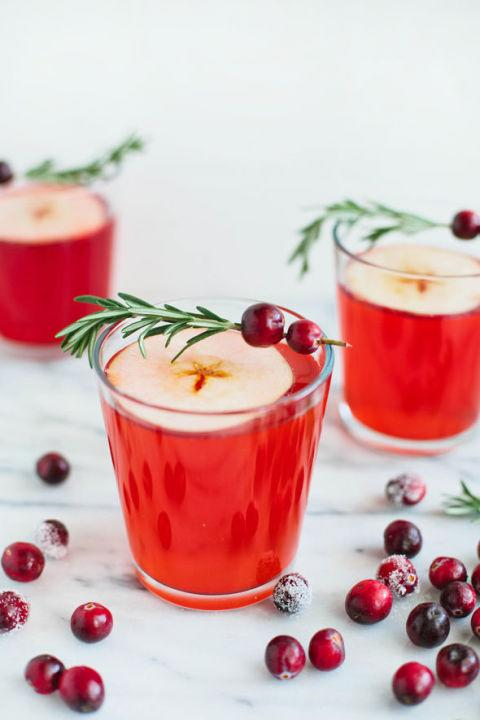 """<p>Cranberry juice gives this drink its gorgeous hue; garnish with a rosemary cranberry sprig for a festive touch. </p><p><strong>Get the recipe at <a rel=""""nofollow"""" href=""""http://sayyes.com/2014/11/fizzy-drinks-for-the-holidays.html"""">Say Yes</a>.</strong> </p>"""