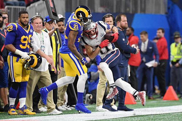 <p>Julian Edelman #11 of the New England Patriots catche a pass against Aqib Talib #21 of the Los Angeles Rams in the first half during Super Bowl LIII at Mercedes-Benz Stadium on February 3, 2019 in Atlanta, Georgia. (Photo by Harry How/Getty Images) </p>