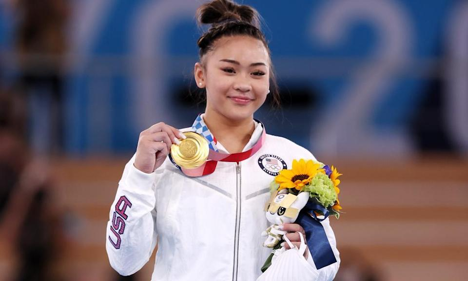 Sunisa Lee poses with her gold medal